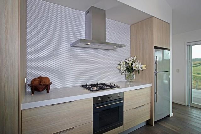 Kitchen featuring melteca seasoned oak cabinetry for Laminex kitchen designs