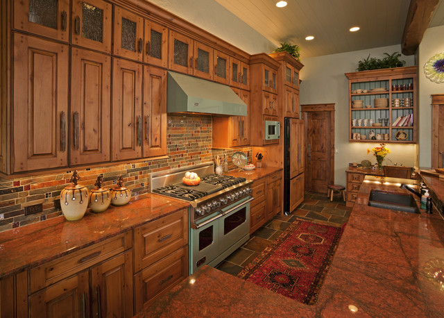 Enclosed kitchen - large rustic l-shaped slate floor and multicolored floor enclosed kitchen idea in Other with raised-panel cabinets, medium tone wood cabinets, an undermount sink, granite countertops, multicolored backsplash, colored appliances, an island and slate backsplash