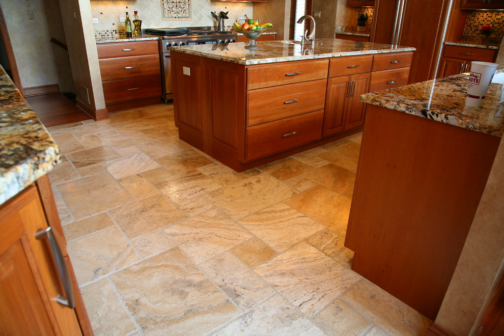 Inspiration for a mid-sized timeless u-shaped travertine floor kitchen remodel in Chicago with a single-bowl sink, shaker cabinets, medium tone wood cabinets, granite countertops, beige backsplash, ceramic backsplash, paneled appliances and an island