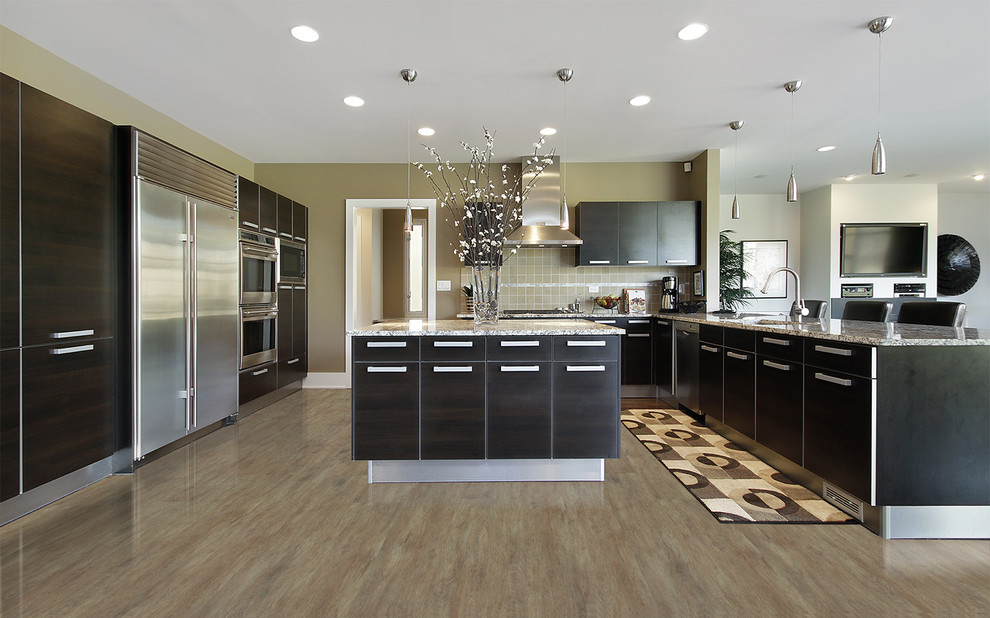 Open concept kitchen - contemporary u-shaped open concept kitchen idea in Ottawa with an undermount sink, flat-panel cabinets, black cabinets, beige backsplash, stainless steel appliances and an island