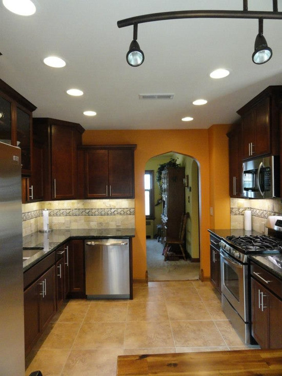 kitchen with staggered cabient and stone back splash -