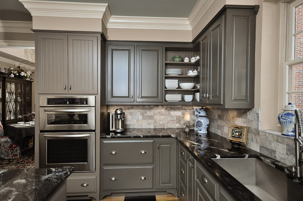 Inspiration for a mid-sized timeless l-shaped painted wood floor kitchen remodel in Other with raised-panel cabinets, gray cabinets, gray backsplash, stainless steel appliances, granite countertops, an island, marble backsplash and an undermount sink