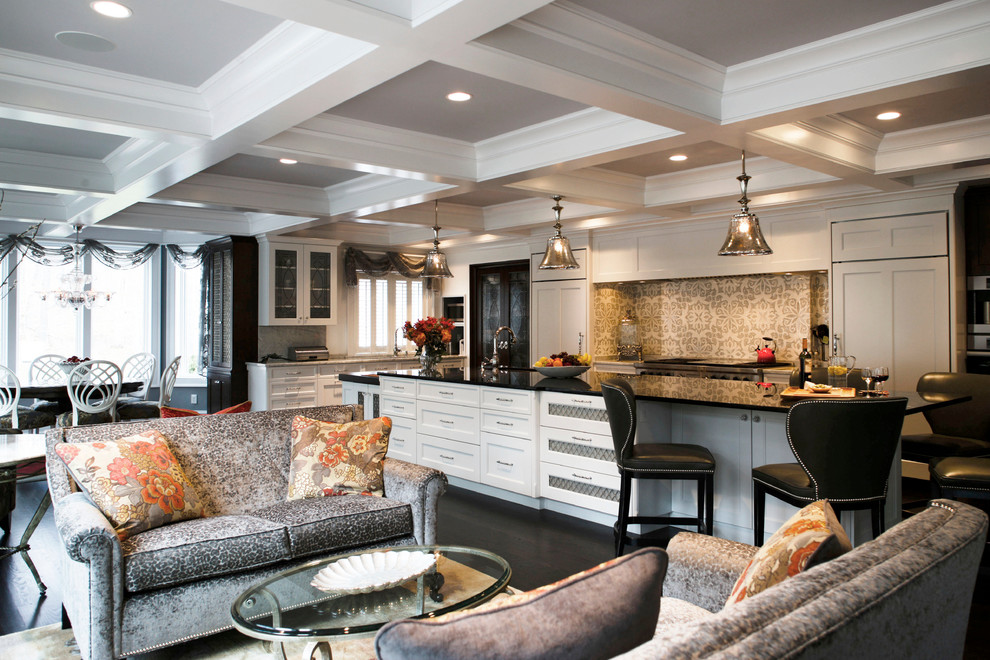 Mid-sized transitional galley dark wood floor open concept kitchen photo in Philadelphia with an undermount sink, white cabinets, granite countertops, gray backsplash, mosaic tile backsplash, stainless steel appliances, an island and glass-front cabinets