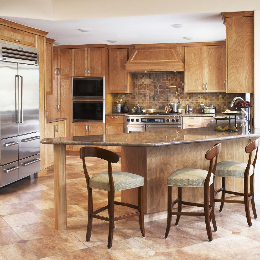 Example of a tuscan u-shaped kitchen design in San Francisco with stainless steel appliances, shaker cabinets, medium tone wood cabinets, brown backsplash and slate backsplash