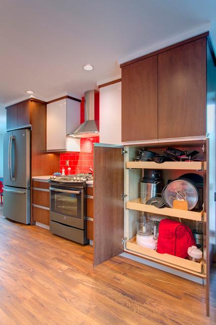 Kitchen has a huge pan appliance storage cabinet