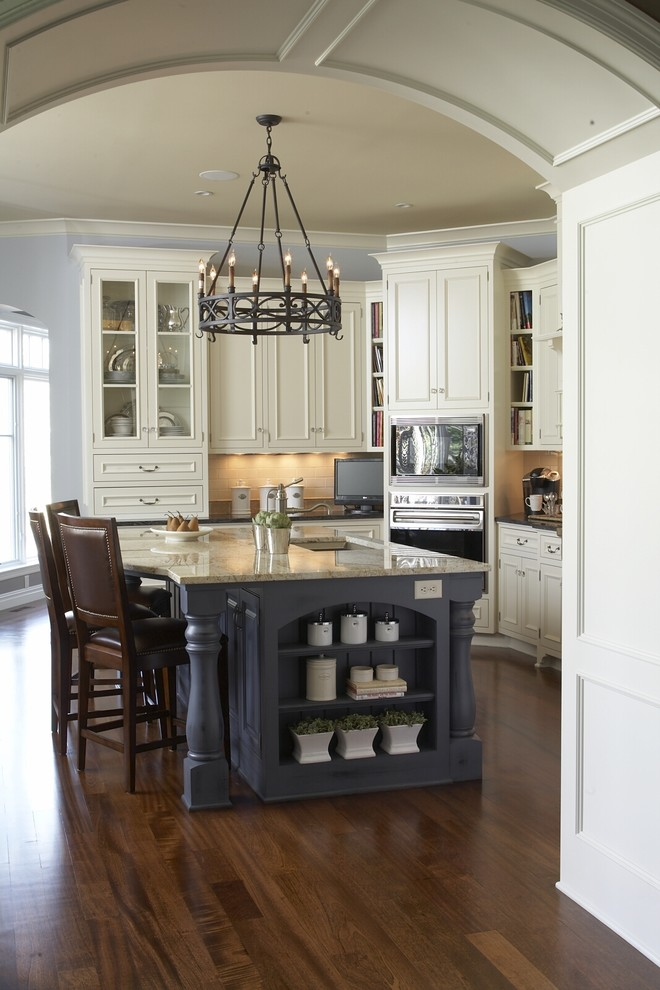Kitchen - traditional kitchen idea in Minneapolis with recessed-panel cabinets, white cabinets and beige backsplash