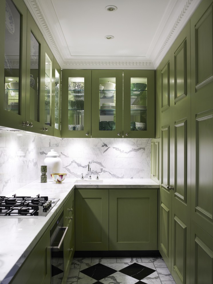 Trendy u-shaped multicolored floor enclosed kitchen photo in Sydney with glass-front cabinets, green cabinets, white backsplash and marble backsplash