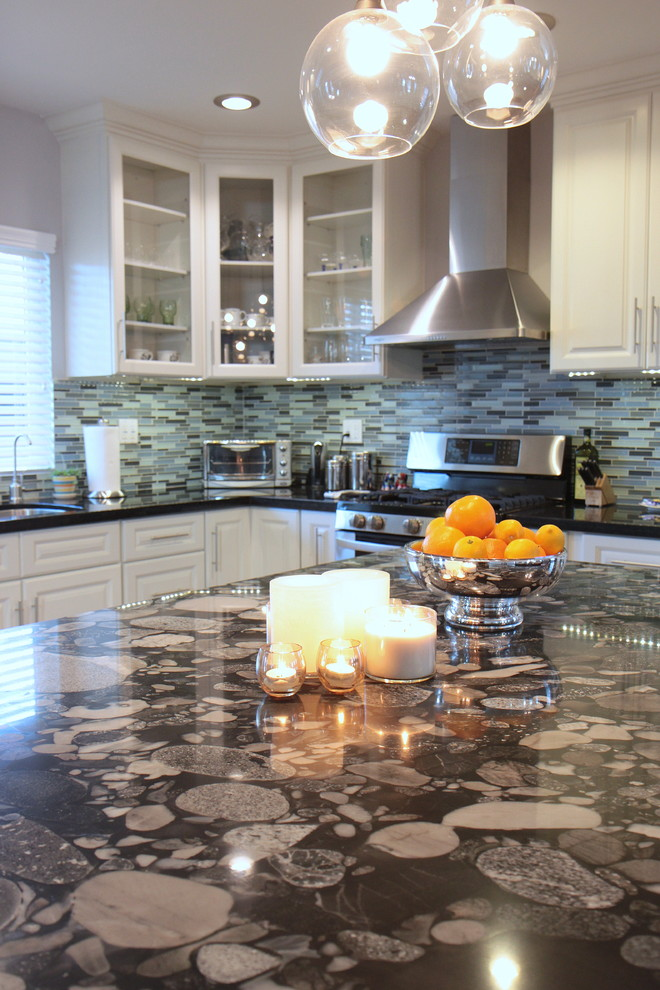 Inspiration for a contemporary kitchen remodel in Los Angeles with glass-front cabinets and stainless steel appliances