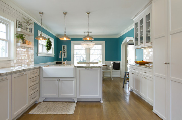 Eat-in kitchen - mid-sized transitional medium tone wood floor eat-in kitchen idea in Kansas City with a farmhouse sink, shaker cabinets, gray cabinets, marble countertops, white backsplash, subway tile backsplash, stainless steel appliances and a peninsula