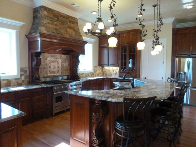 Kitchen in stain grade lyptus wood traditional kitchen for Little rock custom home builders