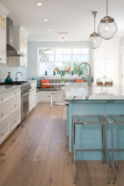 Large coastal l-shaped medium tone wood floor and beige floor eat-in kitchen photo in Denver with a farmhouse sink, shaker cabinets, white cabinets, blue backsplash, mosaic tile backsplash, stainless steel appliances, an island and quartzite countertops