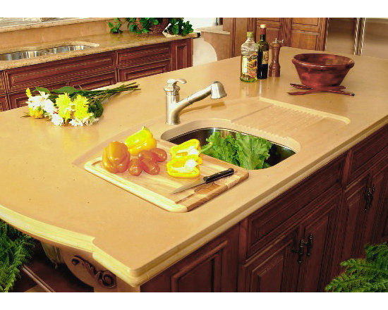 Kitchen Island with Built In Cutting Board and Drying Area - This is a custom kitchen island with a built in drying area and cutting board area. This design keeps the mess of preparing food, and drying the dishes in the sink, not on the counter. Priced at $80 per Square Foot.