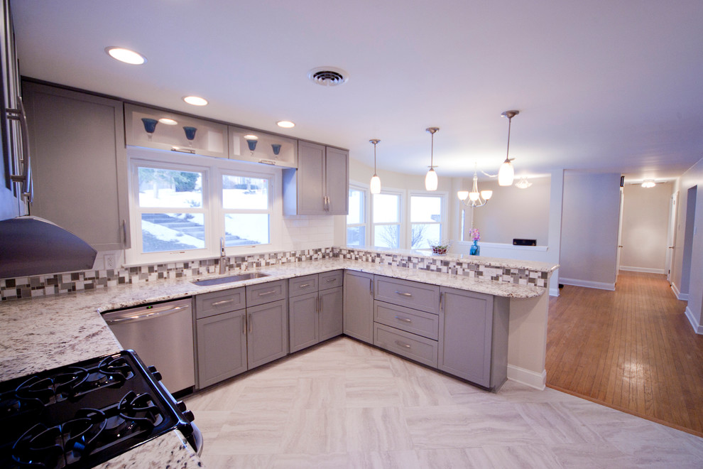 Inspiration for a mid-sized contemporary u-shaped linoleum floor open concept kitchen remodel in Philadelphia with a single-bowl sink, shaker cabinets, gray cabinets, granite countertops, white backsplash, ceramic backsplash, stainless steel appliances and a peninsula