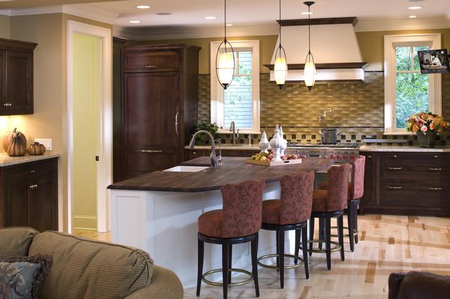 Elegant kitchen photo in Minneapolis with shaker cabinets, dark wood cabinets, wood countertops and beige backsplash