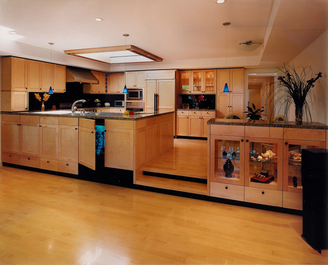 Large Trendy U Shaped Light Wood Floor And Yellow Floor Eat In Kitchen Photo