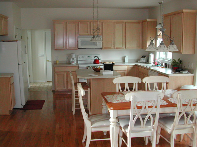 Kitchen Light Stain Wood Cabinets And White Appliances