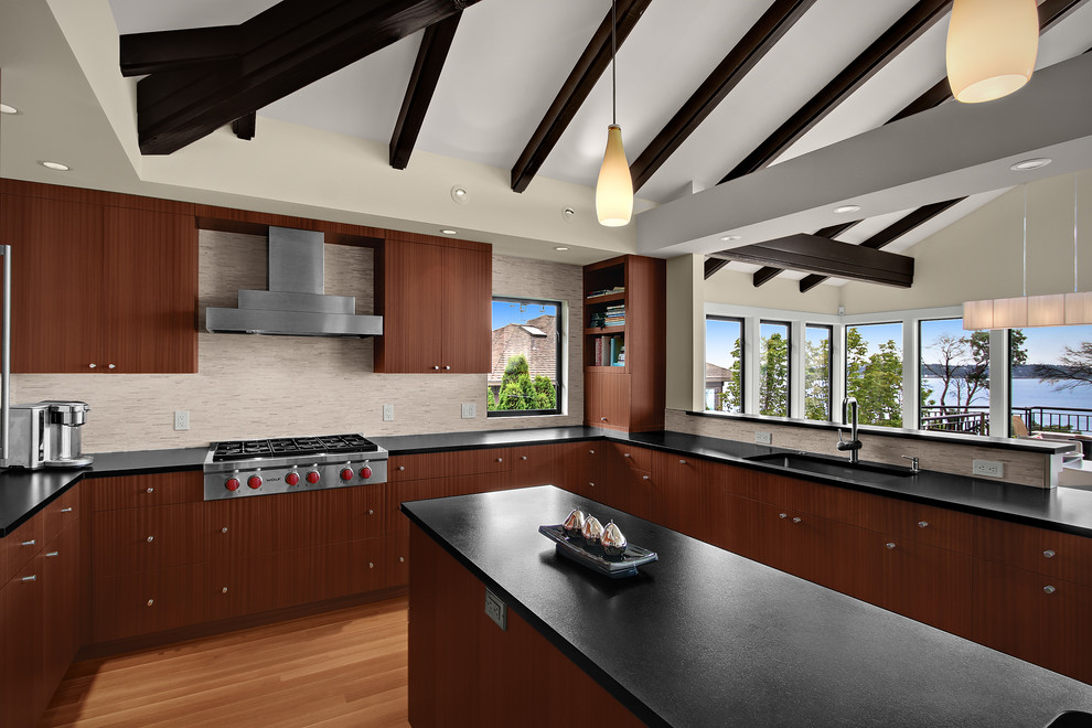 Transitional kitchen photo in Seattle with an undermount sink, flat-panel cabinets, medium tone wood cabinets and stainless steel appliances