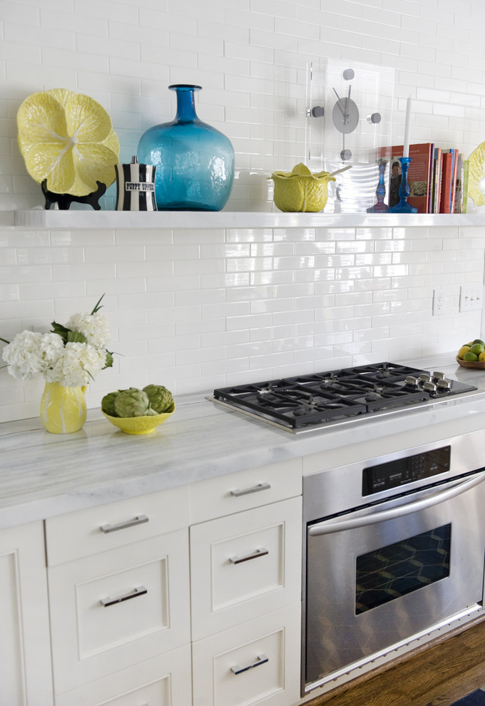Kitchen - contemporary kitchen idea in Charlotte with marble countertops, recessed-panel cabinets, white cabinets, white backsplash and stainless steel appliances
