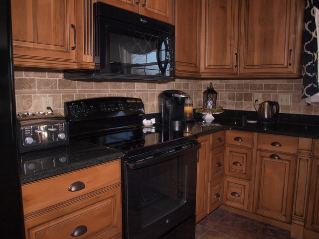 Example Of A Transitional Ceramic Floor Eat In Kitchen Design With Beige Backsplash Stone