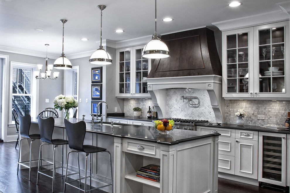 Trendy kitchen photo in Chicago with glass-front cabinets