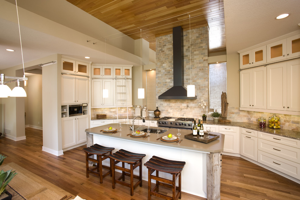 Example of a classic open concept kitchen design in Minneapolis with shaker cabinets, white cabinets, beige backsplash, stainless steel appliances and slate backsplash
