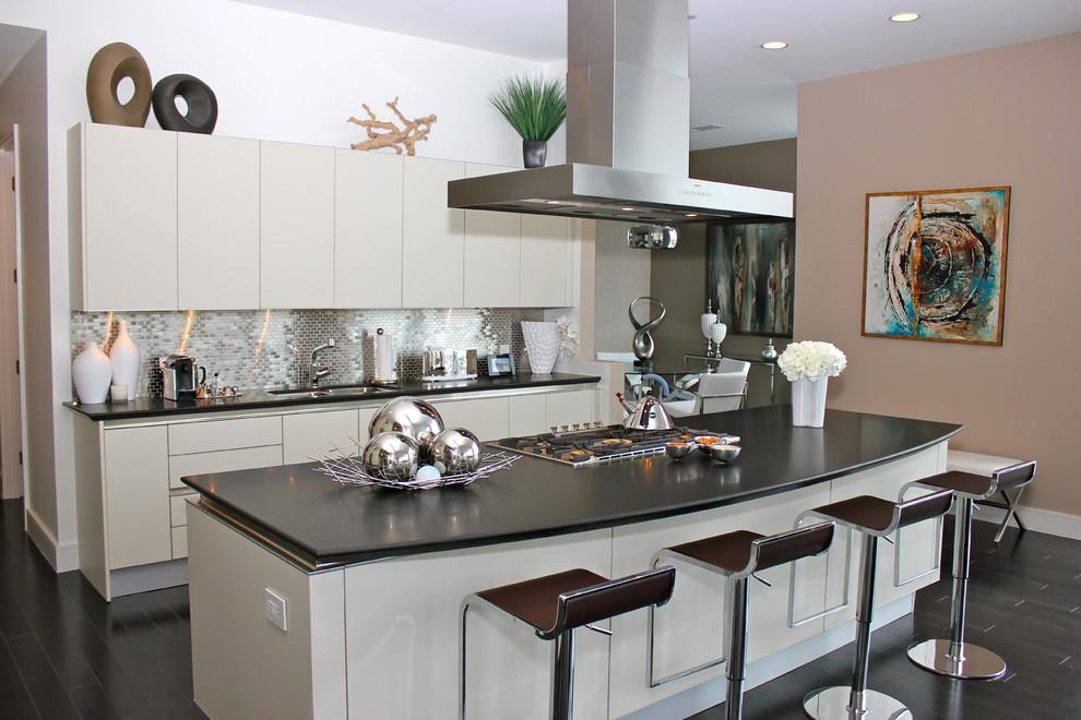 Kitchen - contemporary kitchen idea in Houston with flat-panel cabinets, gray cabinets, metallic backsplash and mosaic tile backsplash