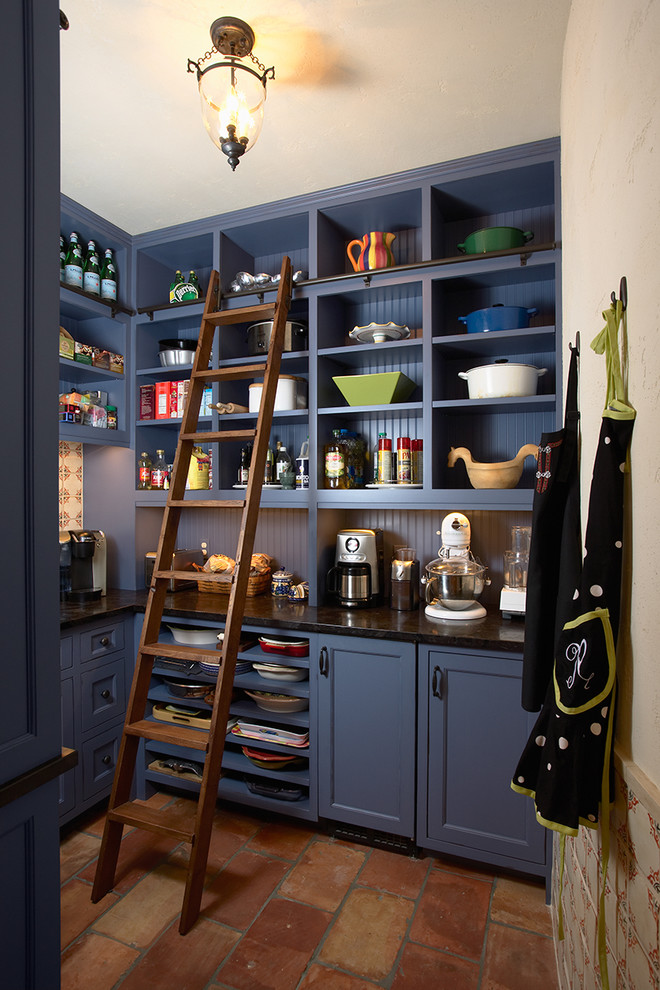 Example of a classic kitchen design in Minneapolis with open cabinets, blue cabinets and black countertops