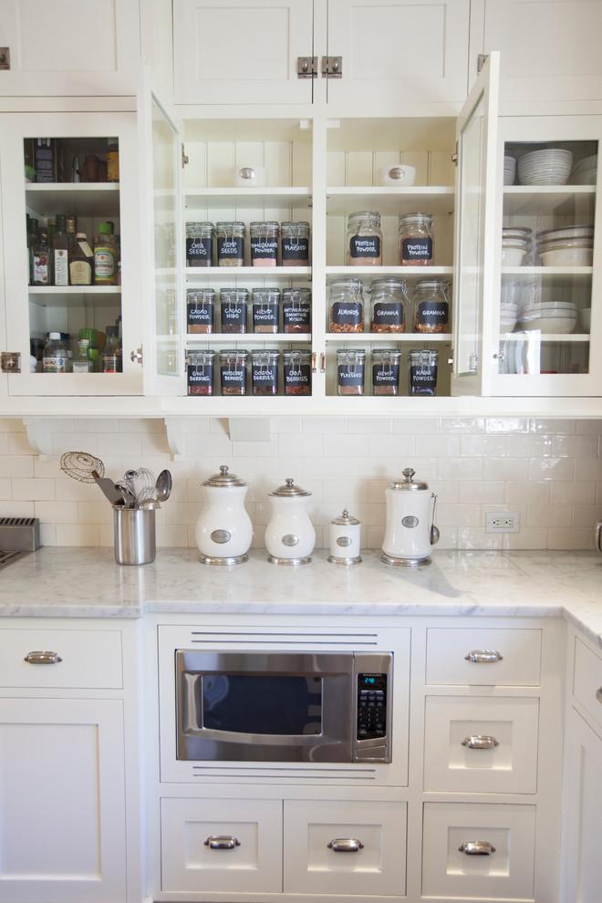 Inspiration for a timeless kitchen remodel in San Diego with white cabinets, white backsplash, subway tile backsplash and shaker cabinets