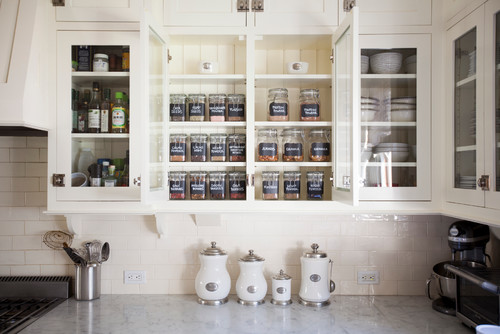 Organized Kitchen Cabinets - Glass Cabinet Fronts and Open Shelving - Labeled Spice Cabinet Glass Bottles