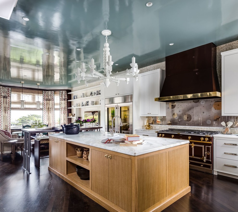 Large transitional single-wall dark wood floor and brown floor open concept kitchen photo in Boston with flat-panel cabinets, white cabinets, multicolored backsplash, black appliances, an island, marble countertops and glass sheet backsplash