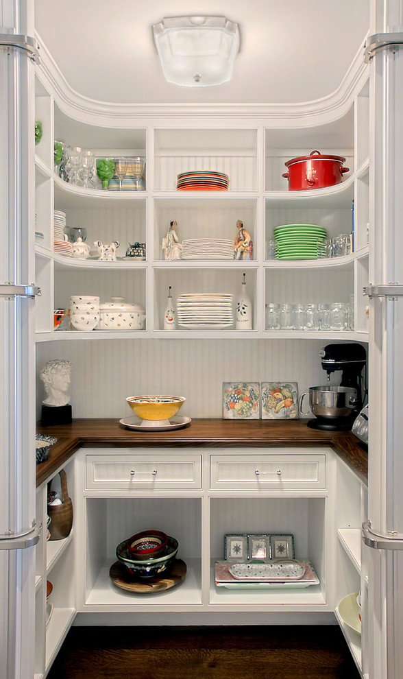 Inspiration for a timeless u-shaped kitchen pantry remodel in Chicago with open cabinets, white cabinets and wood countertops