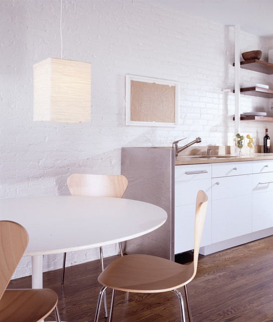 Eat-in kitchen - contemporary eat-in kitchen idea in New York with white cabinets and white backsplash