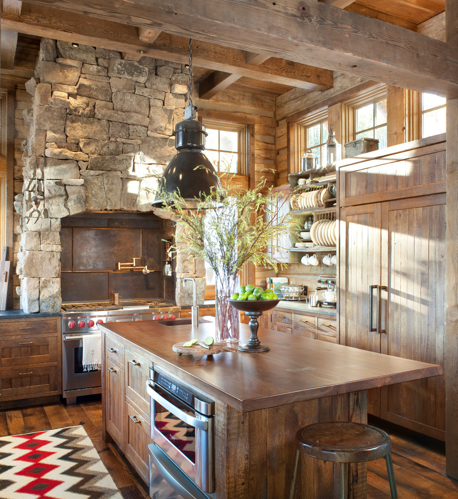Inspiration for a rustic kitchen remodel in Atlanta with paneled appliances, wood countertops, recessed-panel cabinets, medium tone wood cabinets, brown backsplash and metal backsplash