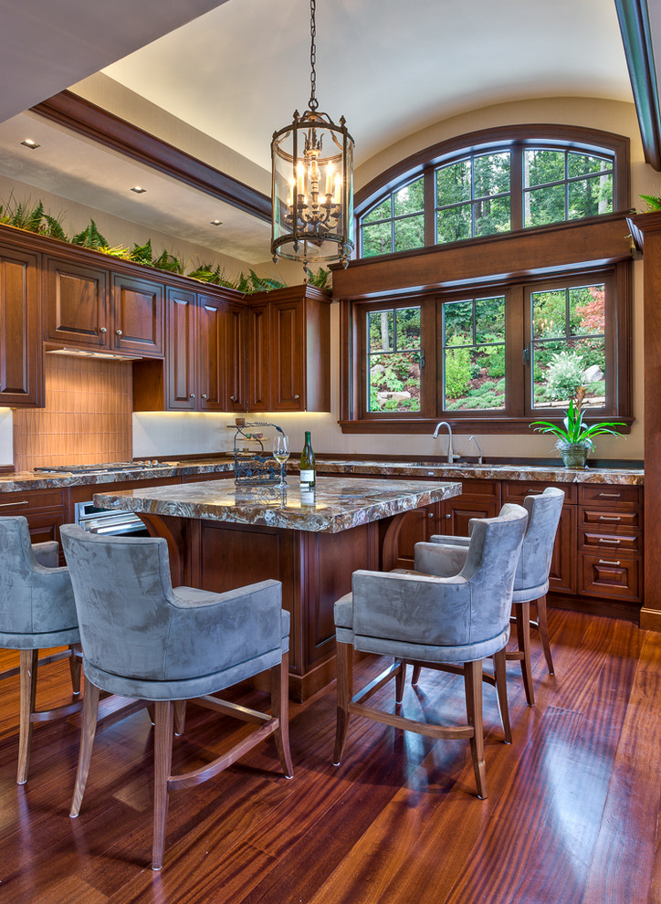 Example of a classic kitchen design in Other with an undermount sink, raised-panel cabinets, dark wood cabinets and beige backsplash