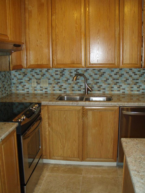 Kitchen redesign with new granite and beach glass tile backsplash contemporary-kitchen