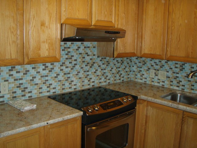 with new granite and beach glass tile backsplash contemporary kitchen