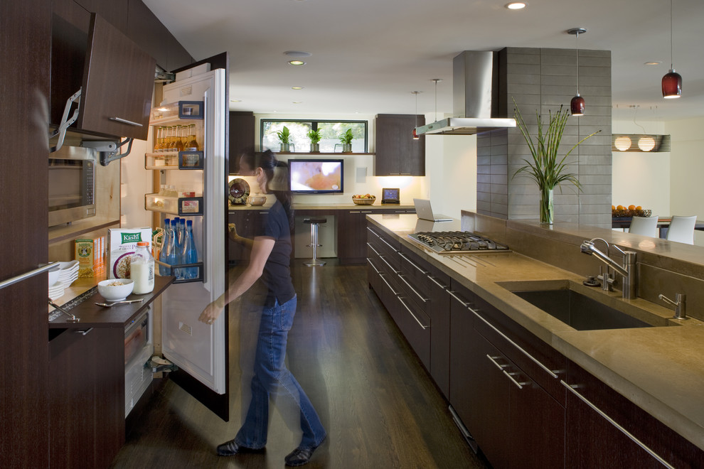 Trendy galley open concept kitchen photo in San Francisco with flat-panel cabinets, dark wood cabinets and a single-bowl sink