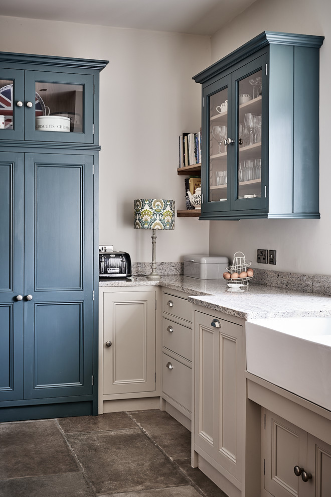 Example of a large classic ceramic tile and brown floor eat-in kitchen design in Other with a farmhouse sink, beaded inset cabinets, gray cabinets, granite countertops, blue backsplash, mosaic tile backsplash, colored appliances, no island and gray countertops