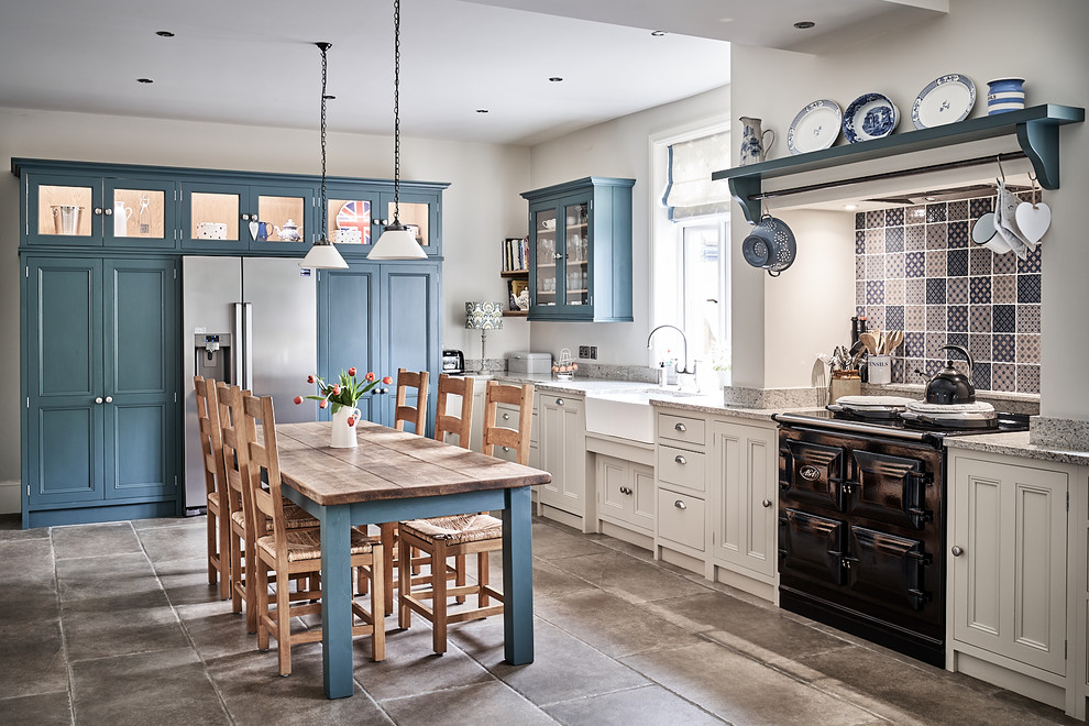 Eat-in kitchen - large traditional l-shaped ceramic tile and gray floor eat-in kitchen idea in Other with a farmhouse sink, beaded inset cabinets, granite countertops, mosaic tile backsplash, no island, gray countertops, beige cabinets, multicolored backsplash and black appliances