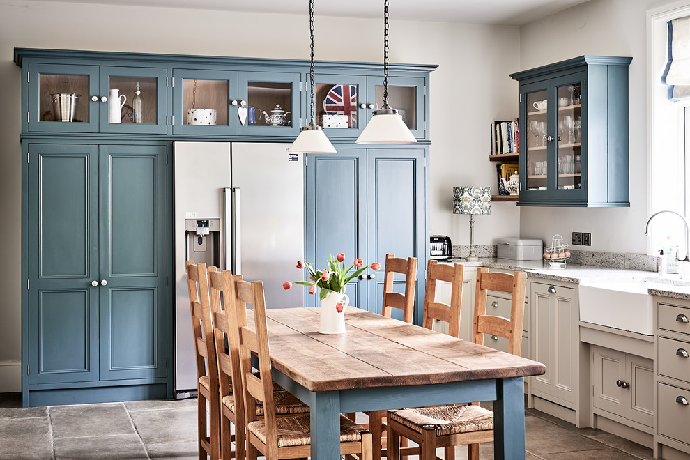 Large elegant ceramic tile and brown floor eat-in kitchen photo in Other with a farmhouse sink, beaded inset cabinets, gray cabinets, granite countertops, blue backsplash, mosaic tile backsplash, colored appliances, no island and gray countertops