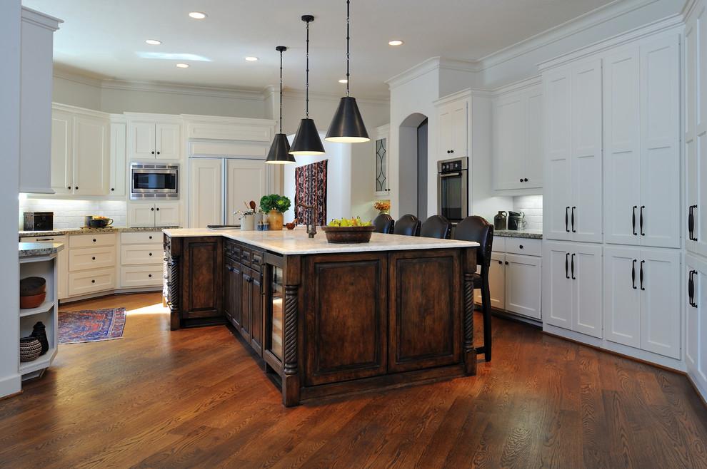 Kitchen - mediterranean kitchen idea in Houston with limestone countertops