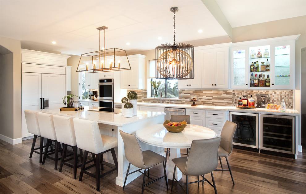 Large transitional single-wall laminate floor eat-in kitchen photo in Phoenix with an undermount sink, raised-panel cabinets, white cabinets, quartz countertops, multicolored backsplash, mosaic tile backsplash, paneled appliances and an island