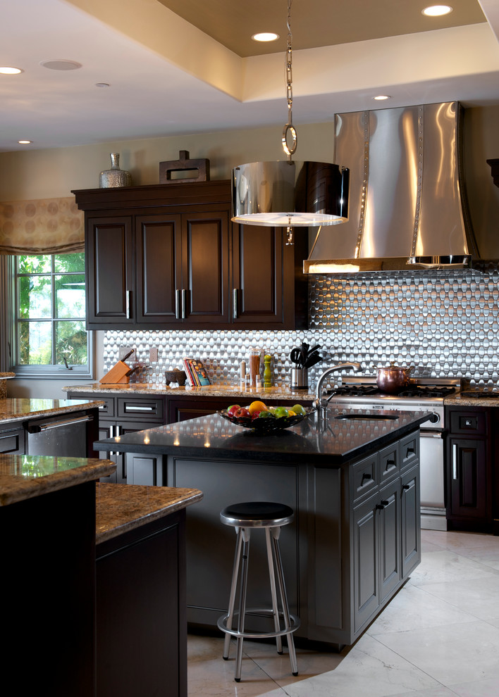Inspiration for a large transitional l-shaped limestone floor and beige floor open concept kitchen remodel in Orange County with raised-panel cabinets, dark wood cabinets, metallic backsplash, stainless steel appliances, an undermount sink, granite countertops, metal backsplash and two islands