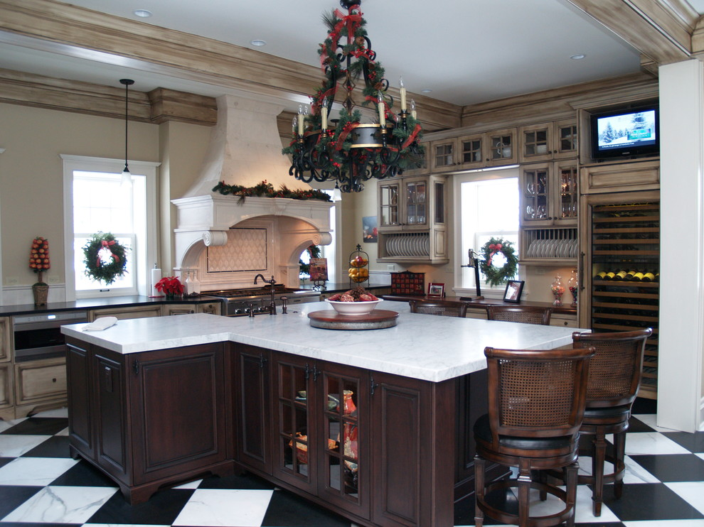 Example of a classic kitchen design in Cleveland with glass-front cabinets