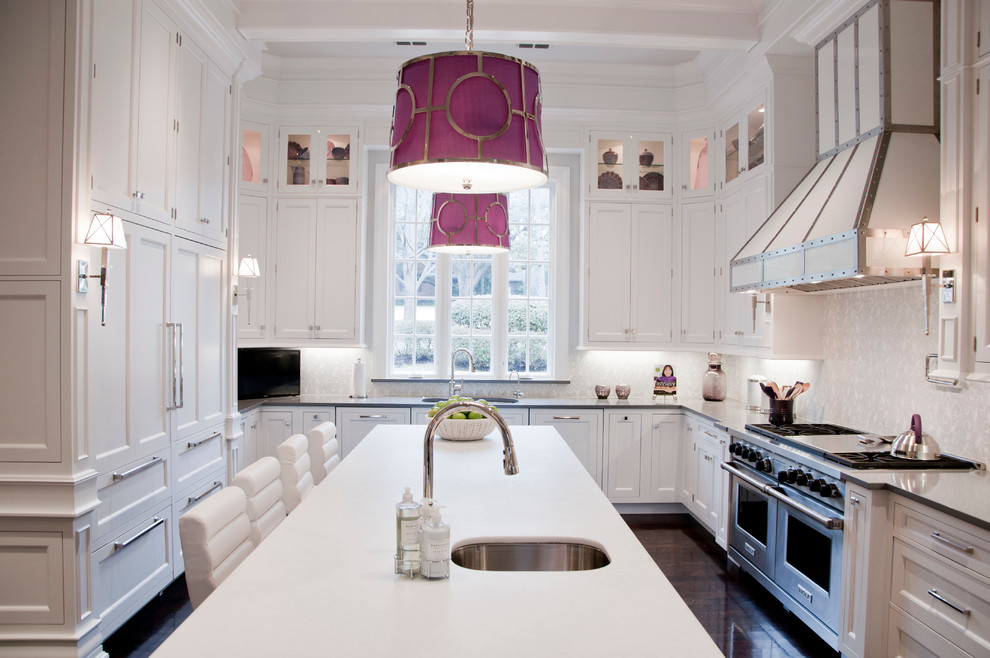 Large elegant u-shaped dark wood floor kitchen photo in Dallas with an undermount sink, recessed-panel cabinets, white cabinets, white backsplash, stainless steel appliances and an island