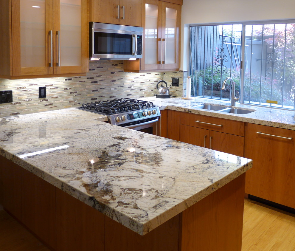 Trendy u-shaped kitchen photo in Salt Lake City with an undermount sink, granite countertops and stainless steel appliances