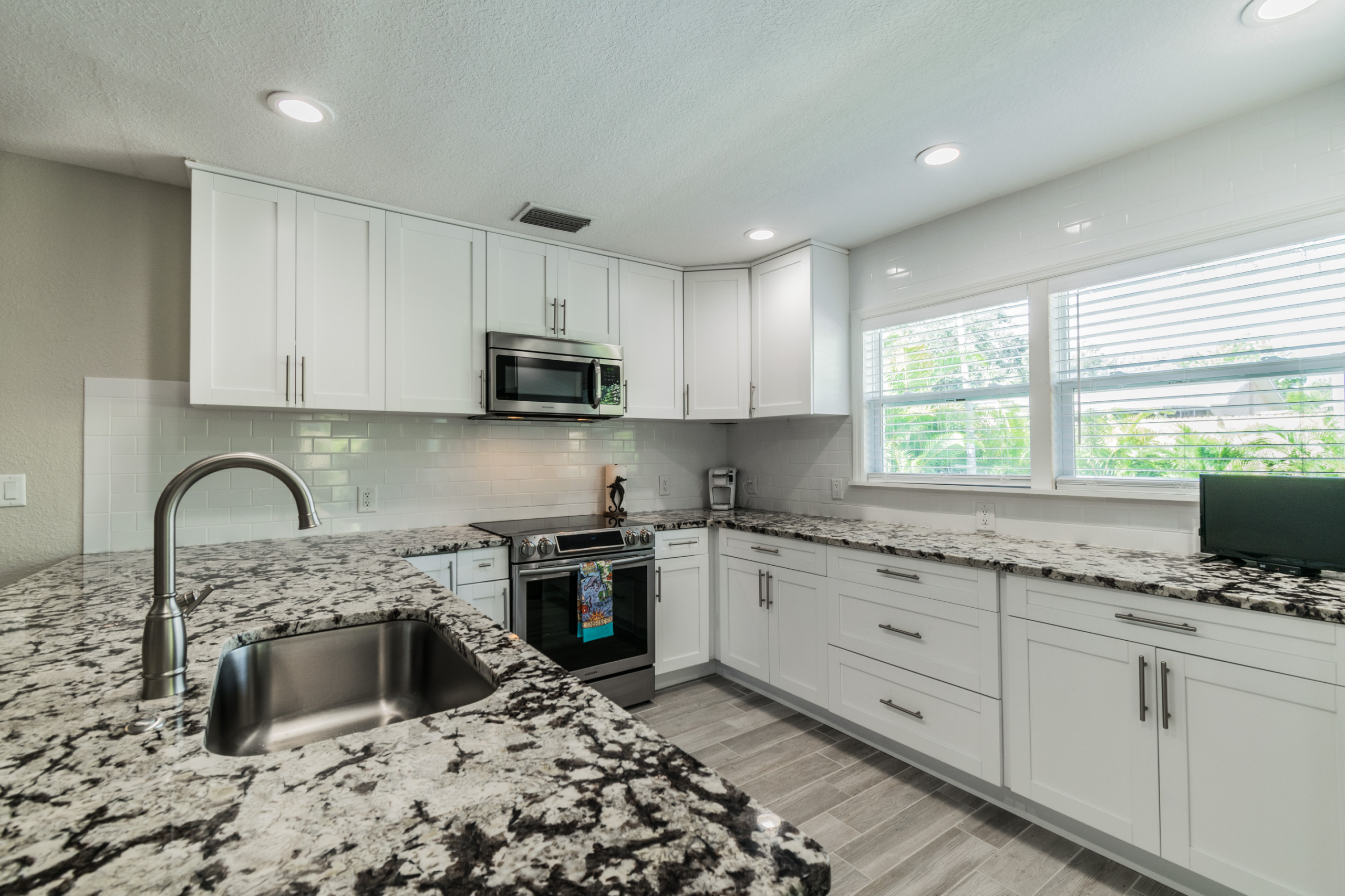 Kitchen remodel with shaker cabinets and granite counters