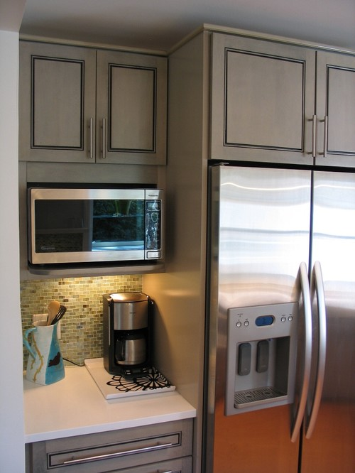 What brand is this microwave and how deep are the upper cabinets?