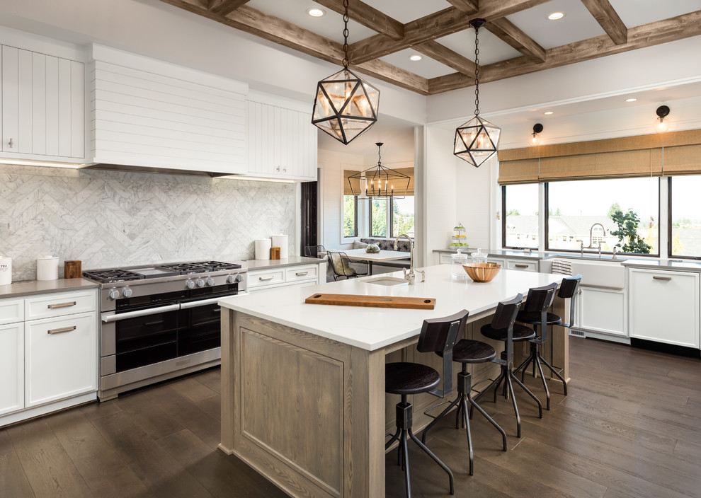 Example of a large cottage medium tone wood floor and brown floor eat-in kitchen design in San Francisco with white cabinets, quartzite countertops, multicolored backsplash, marble backsplash and stainless steel appliances