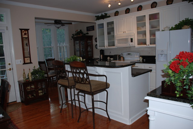 Kitchen Remodeling With Both Cabinet Refacing and New Cabinets traditional-kitchen